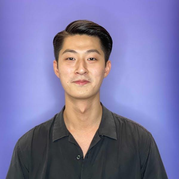 young man wearing a black shirt smiling