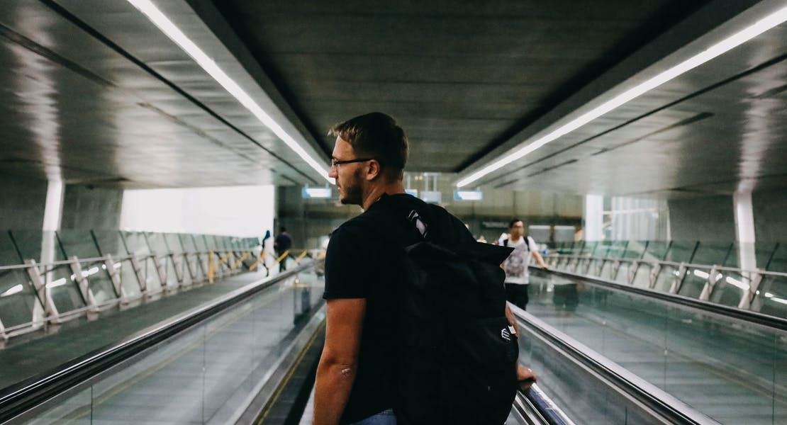 man at travelator of Singapore Changi Airport