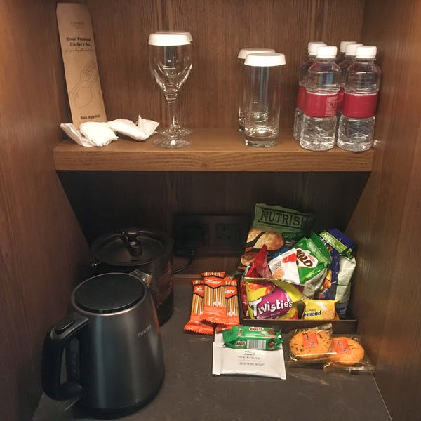 stash of drinks, snacks, kettle and ice container