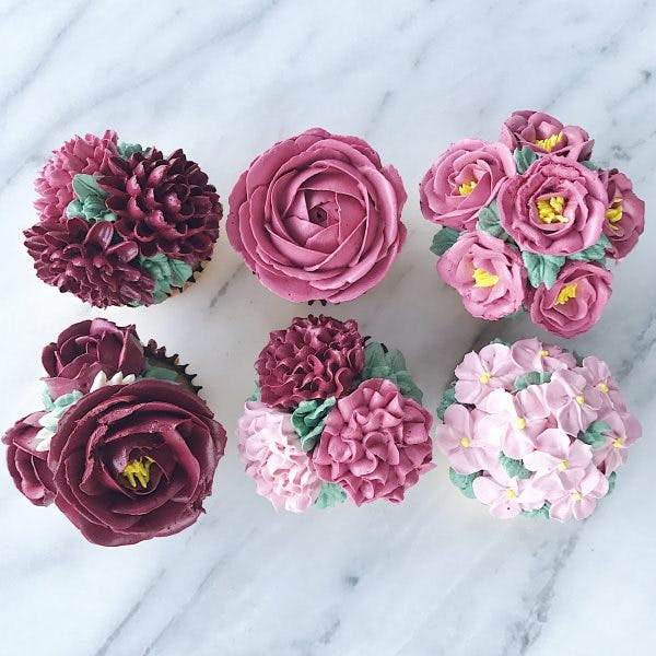 Beautifully hand-piped petals on 6 different cupcakes