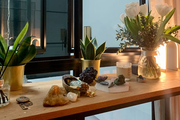 collection of crystals by the window on the study desk, with some plants by the side
