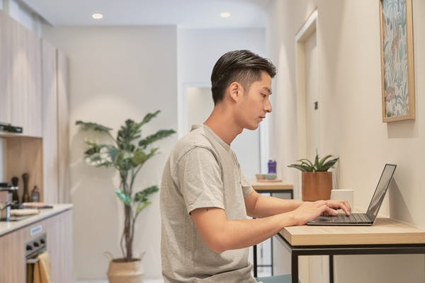 young man doing work on a laptop