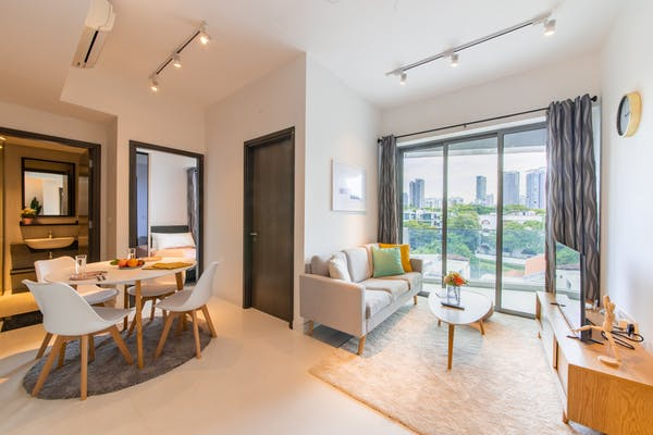 condominium showcasing the living room and dining area which are fully furnished, overlooking the city view