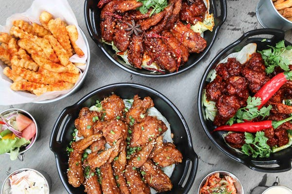 different flavours of korean fried chicken in a pot