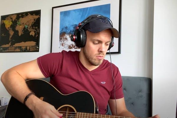Jake focusing on playing the guitar