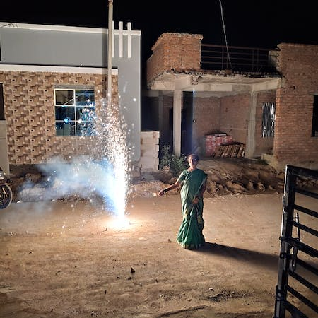 Aditya mom in her saree, beside fireworks