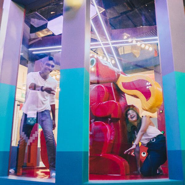 interracial couple playing indoor games at bugis+, trapped in a dragon's dungeon