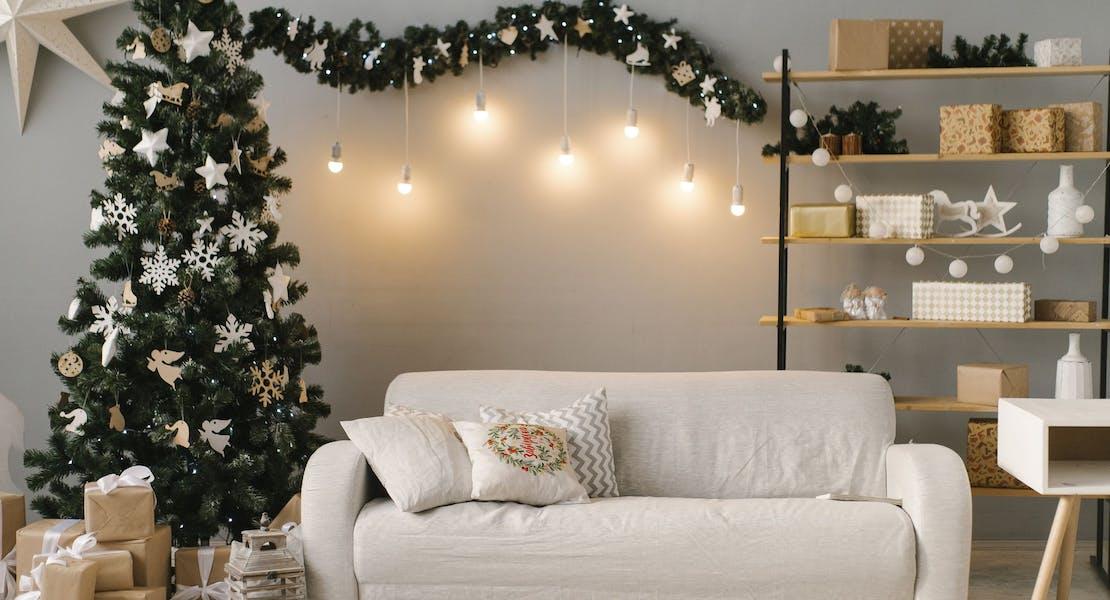 white sofa beside christmas tree