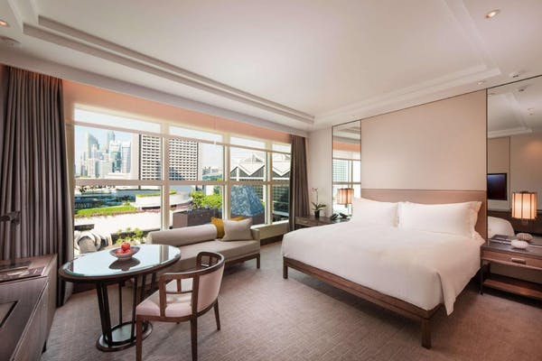 conrad hotel, with queen bed, sofa and coffee table