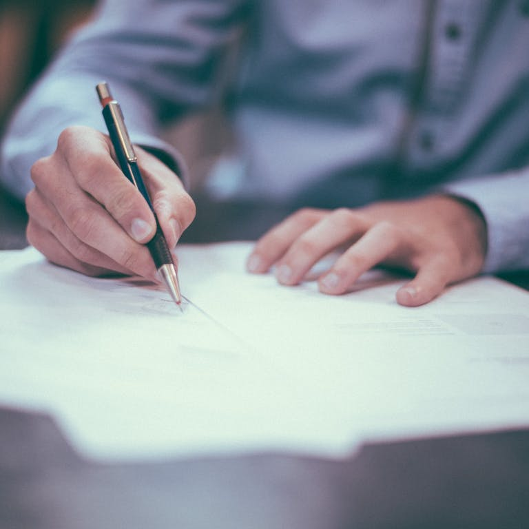 A business person signing a contract