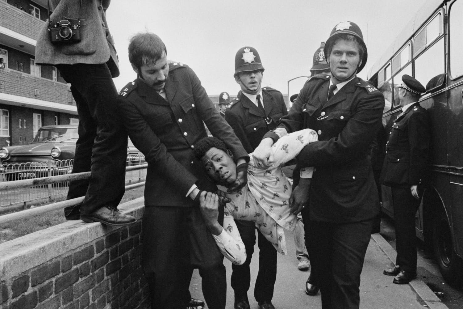 Chris Steele-Perkins Rioters held back by police at National Front Demo. London. England. GB. 1977.