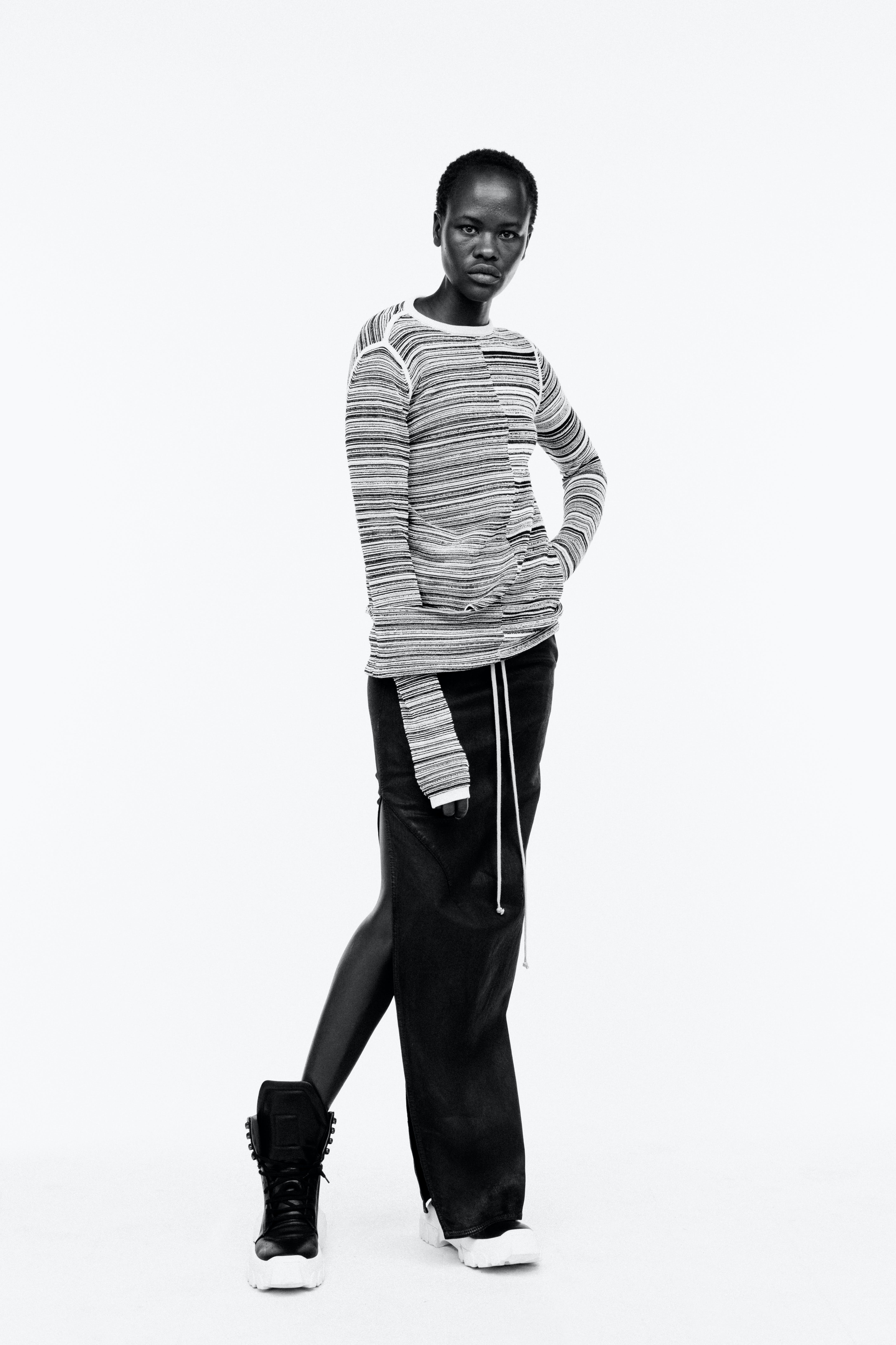 Rick Owens Campaign Stripe Jumper Drawstring Slit Leather Skirt in Black High Top Tracktor Sneakers in Black Womens SS19 Pre Collection