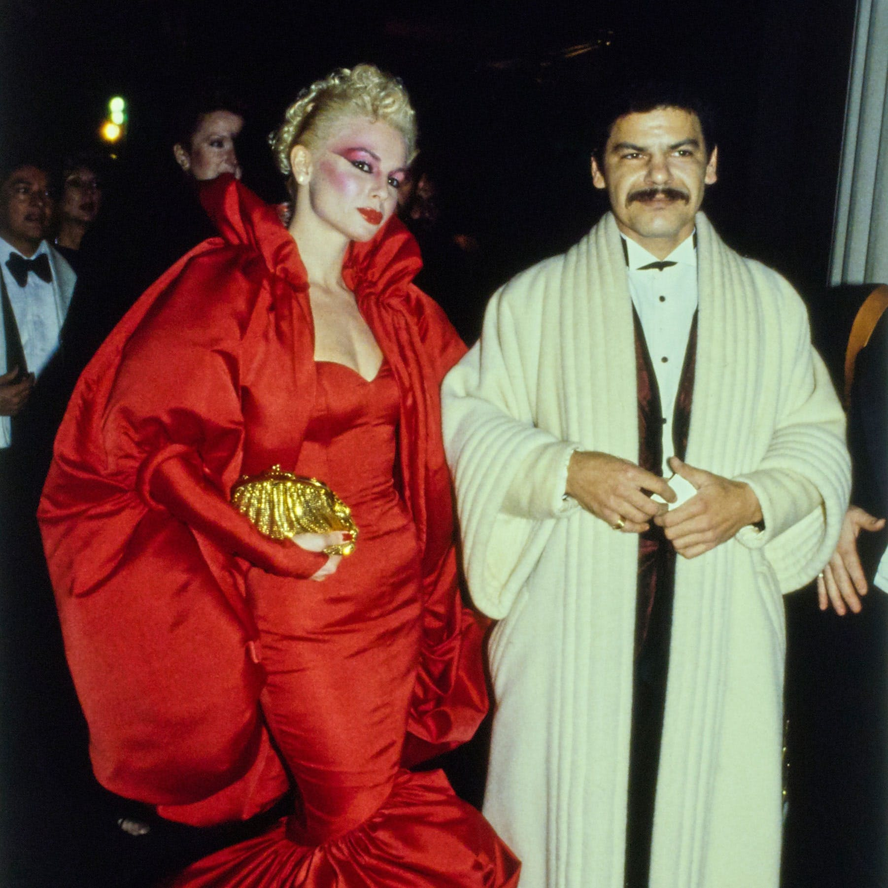 Val LeGaspi in a Larry LeGaspi dress and Thinsulate-lined coat with her husband Larry LeGaspi at the 1979 Met Gala.