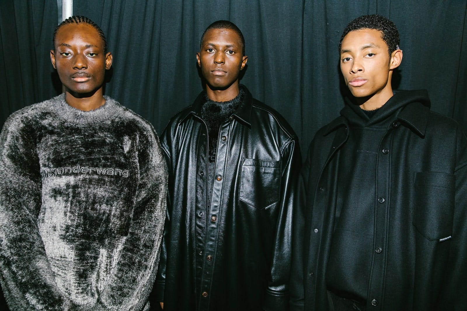 Alexander Wang Backstage Models in Embroidered Logo Pullover in Grey Oversized Long Shirt Jacket in Leather and Embroidered Logo Hoodie in Black Spring 20 RTW