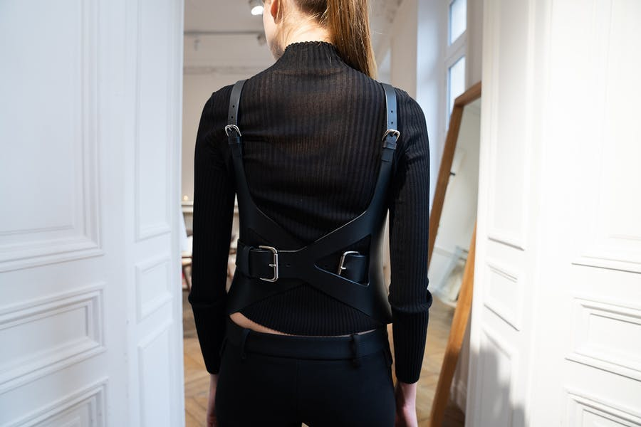 Dion Lee Backstage Long Sleeve Rib Tee in Black Cotton Cross Back Buckle Holster in Black Leather Low Rise Trousers in Black Back View Spring 20 RTW