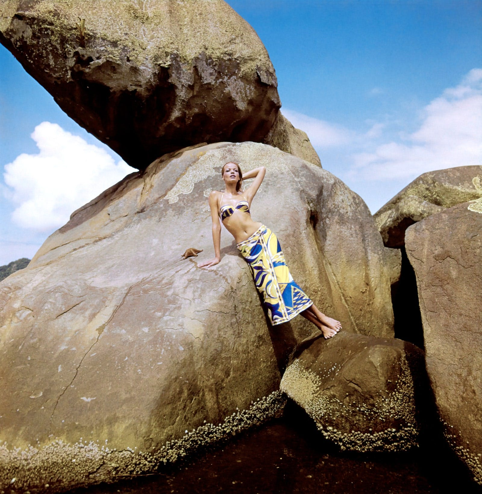 Veruschka in an Emilio Pucci top and sarong in Angra dos Reis, Brazil. Photographed by Henry Clarke, Vogue, June 1965.