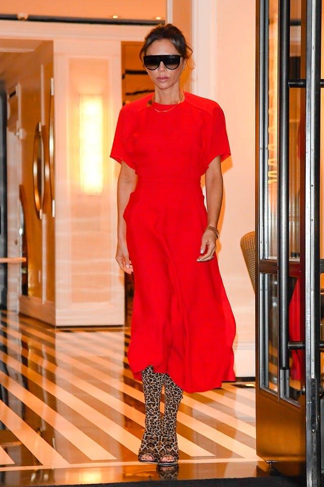 Victoria Beckham wearing long red dress