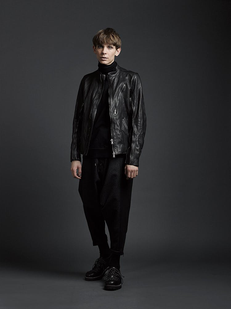 The Viridi-Anne Campaign Zip Detail Round Neck Jacket in Black Leather Turtle Neck in Black Drawstring Loose Fit Trousers AW19