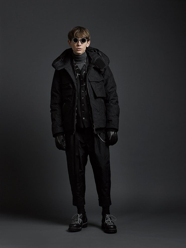 The Viridi-Anne Campaign Rigards Collaboration Sunglasses in Grey High Standing Collar Padded Jacket in Black Turtle Neck in Grey AW19