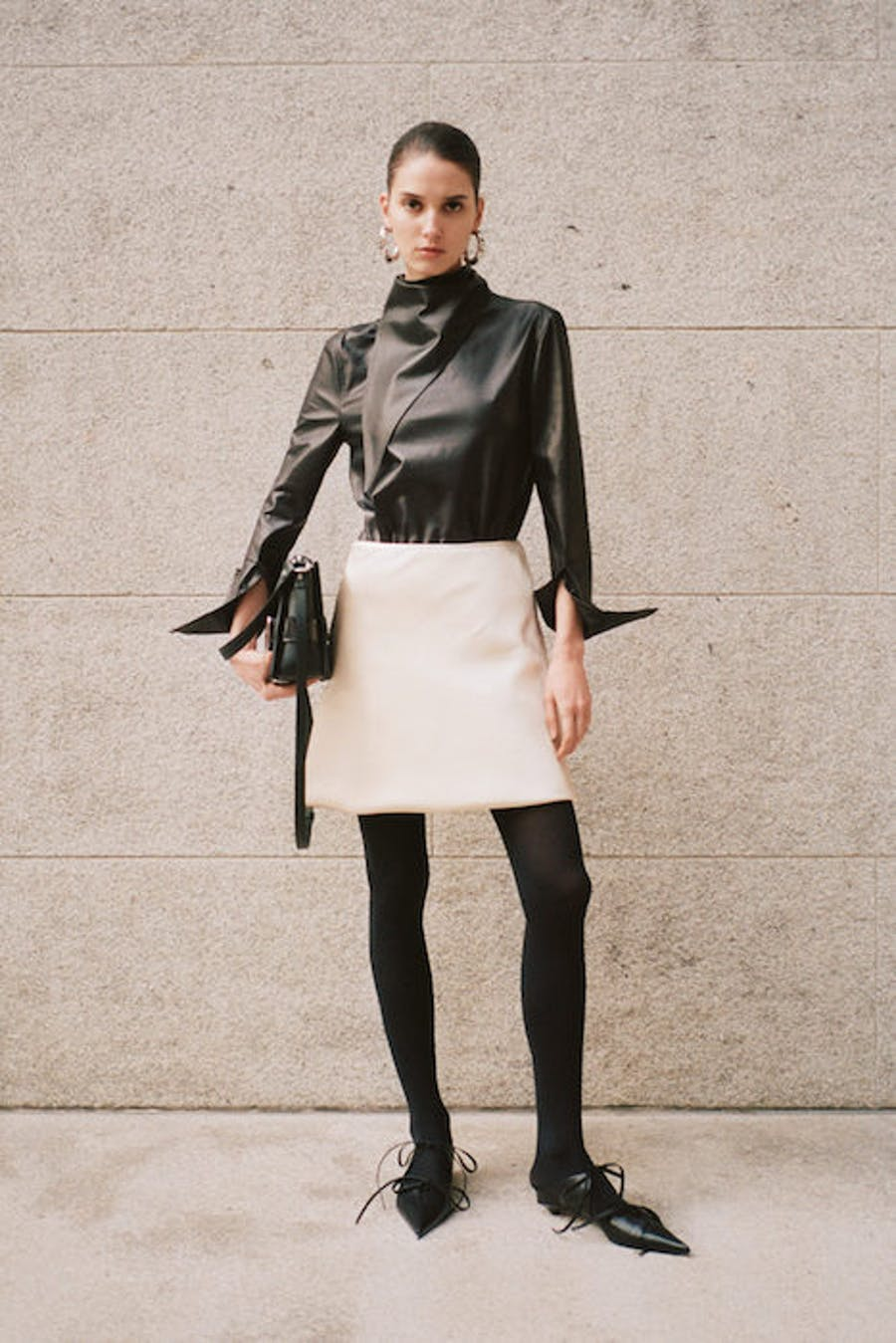 Proenza Schouler High Neck Top in Black Leather White Mini Skirt in White Black Leggings Tie Up Flats Pre Fall 20