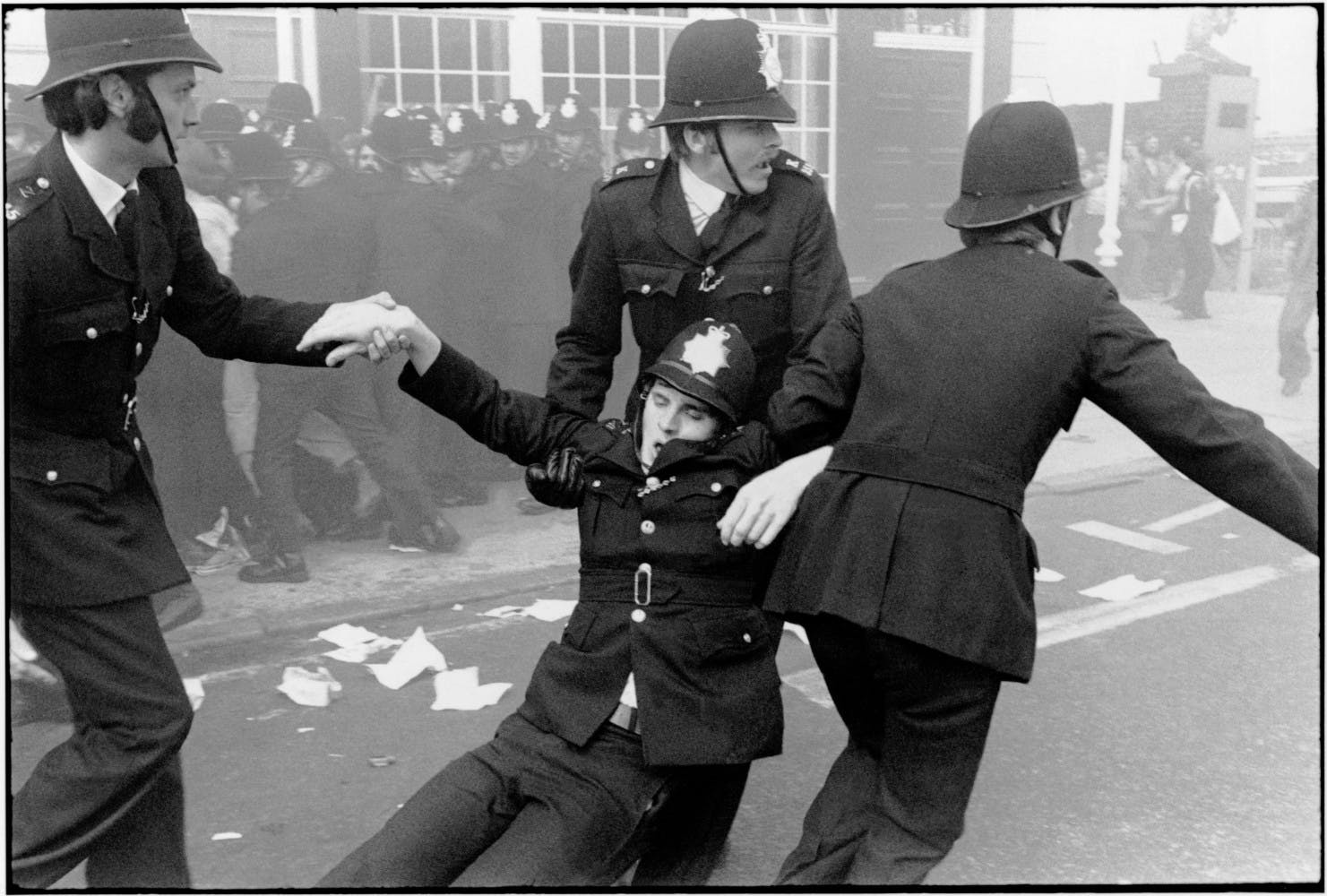 Chris Steele-Perkins Injured policeman during a National Front Demo. London. England. GB. 1977.
