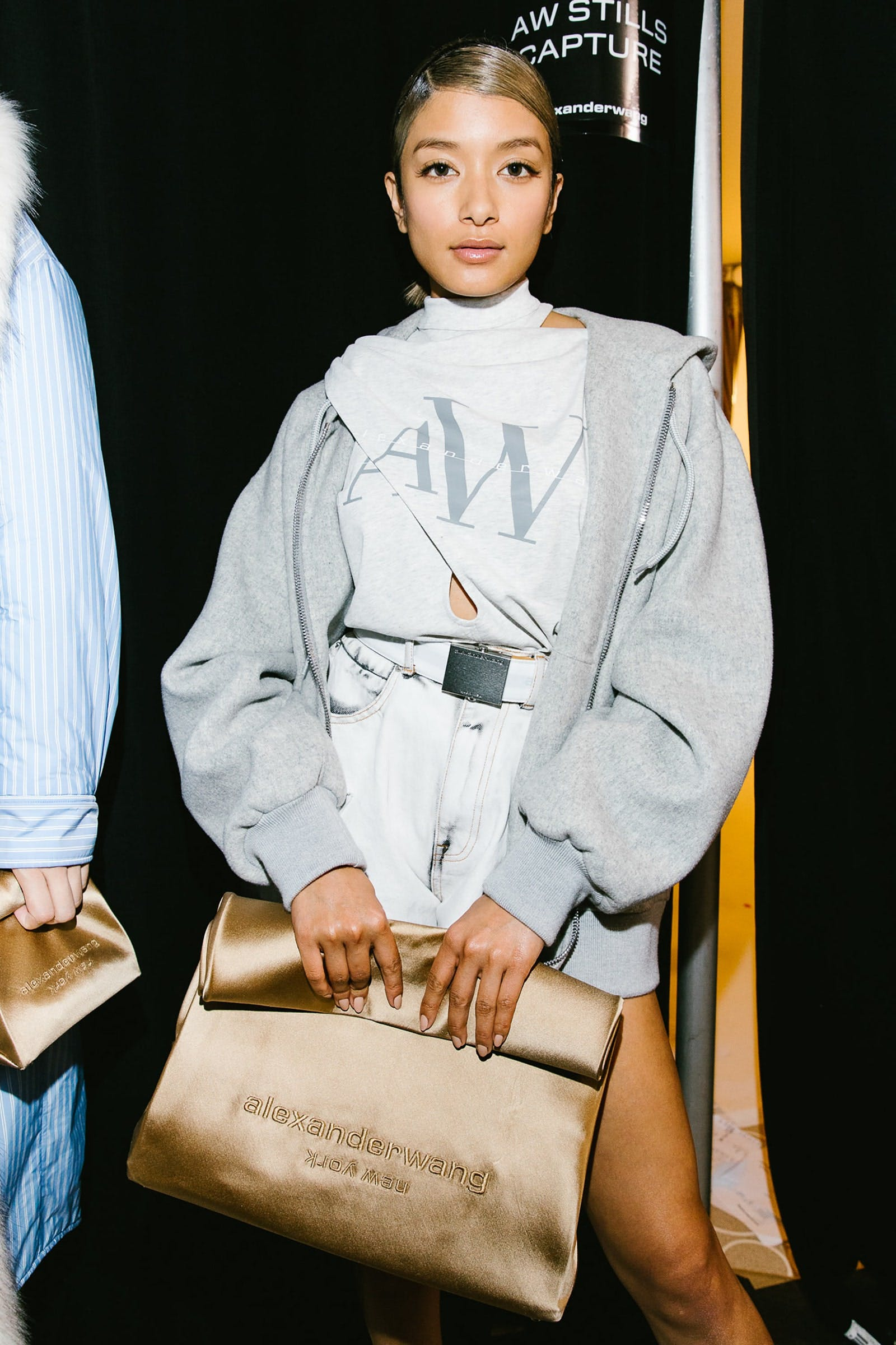 Alexander Wang Backstage Model in Tie Neck Logo Tee in Grey Oversized Zip Up in Light Grey and Bite Shorts Spring 20 RTW