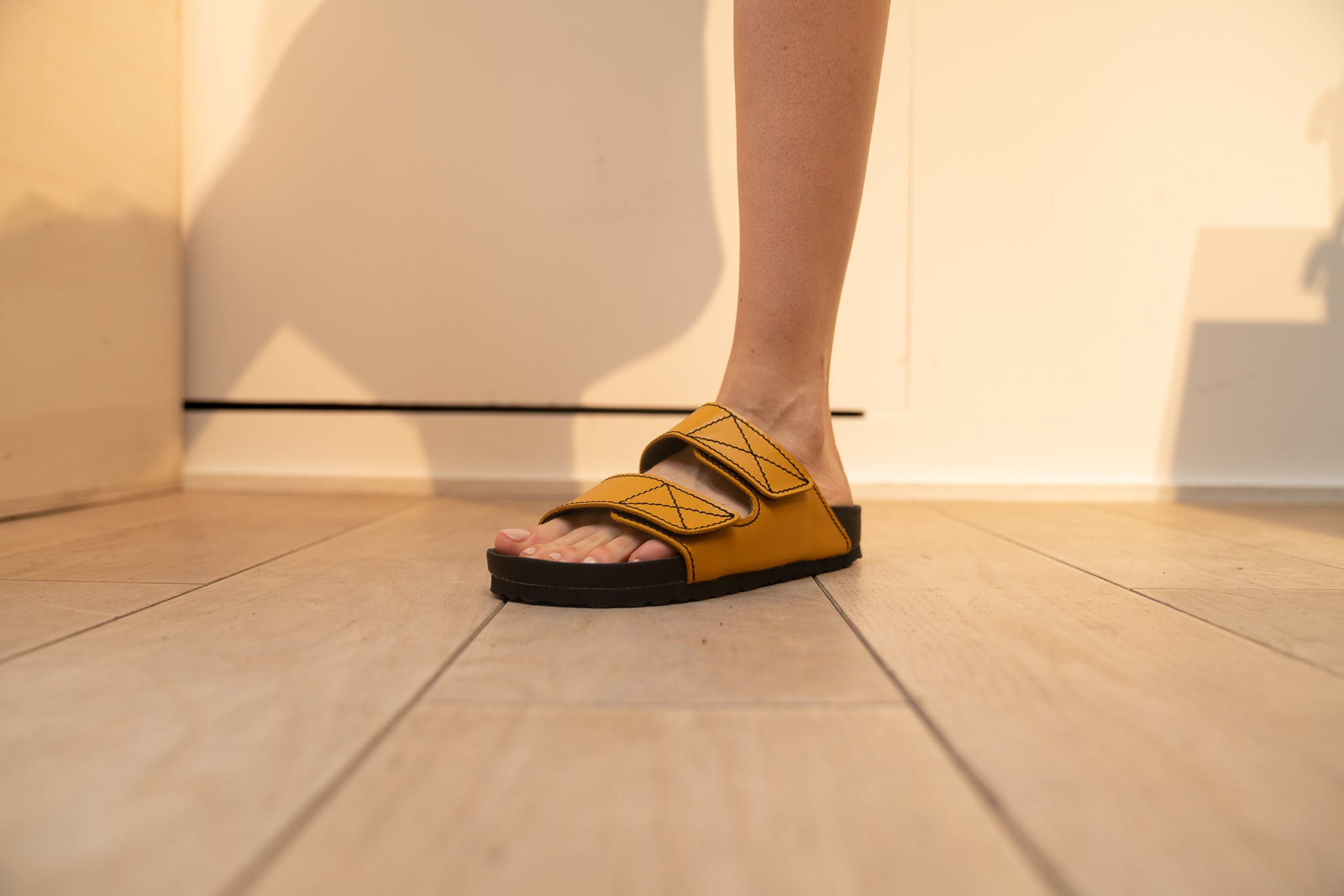 Proenza Schouler Showroom	Birkenstock Collaboration Arizona Slides in Ochre SS20 RTW
