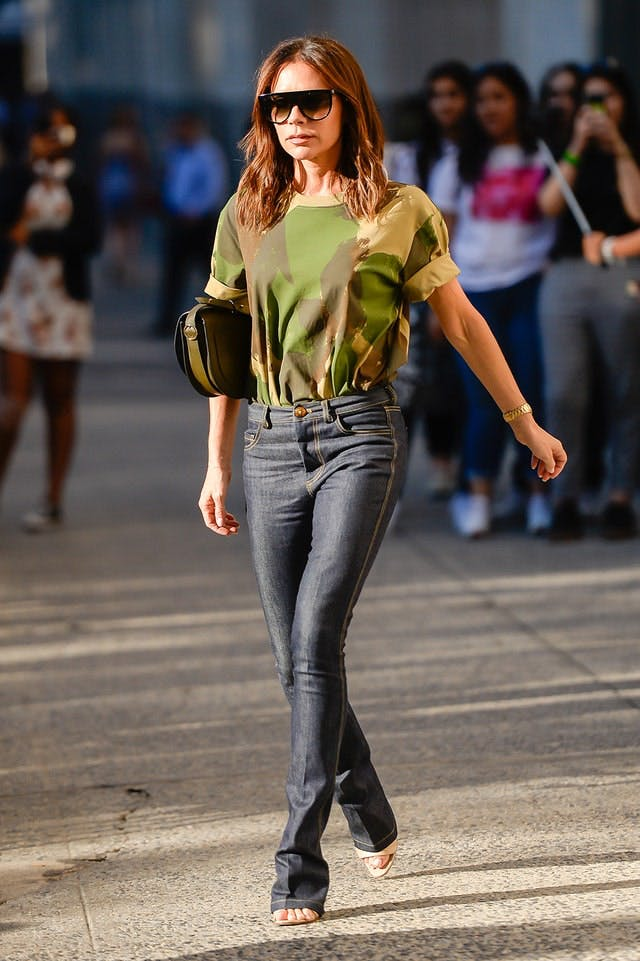 Victoria Beckham wearing a tee tucked into her jeans