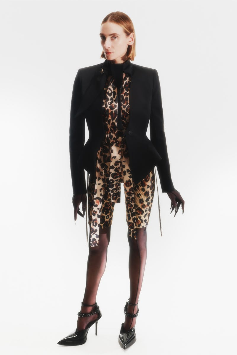 Mugler Campaign Knotted Neck Peplum Jacket in Black Leopard Print Top Bonded Scuba Cycling Shorts in Leopard Print Resort 20