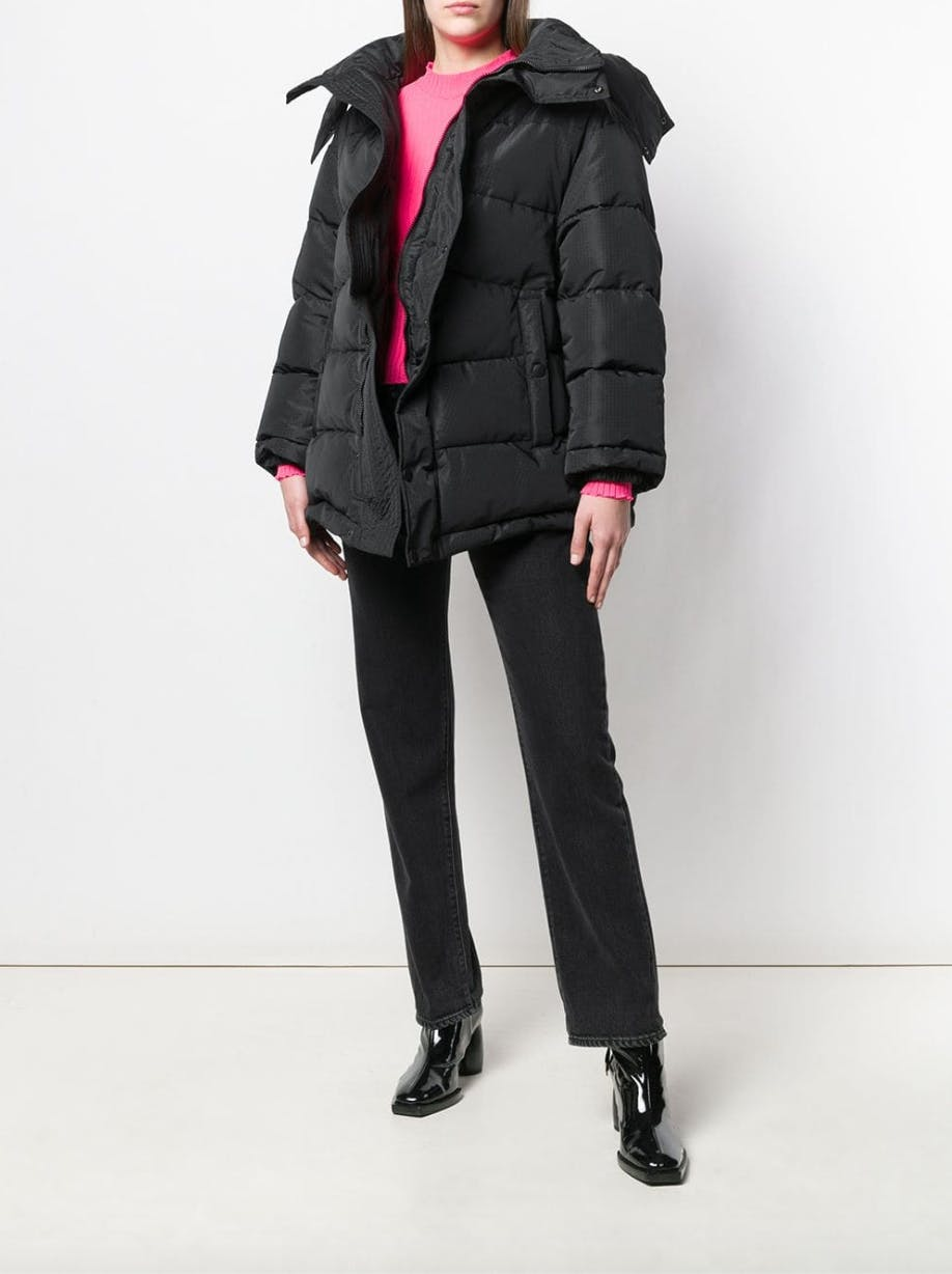 balenciaga black puff jacket pink sweater black jeans black heeled boots