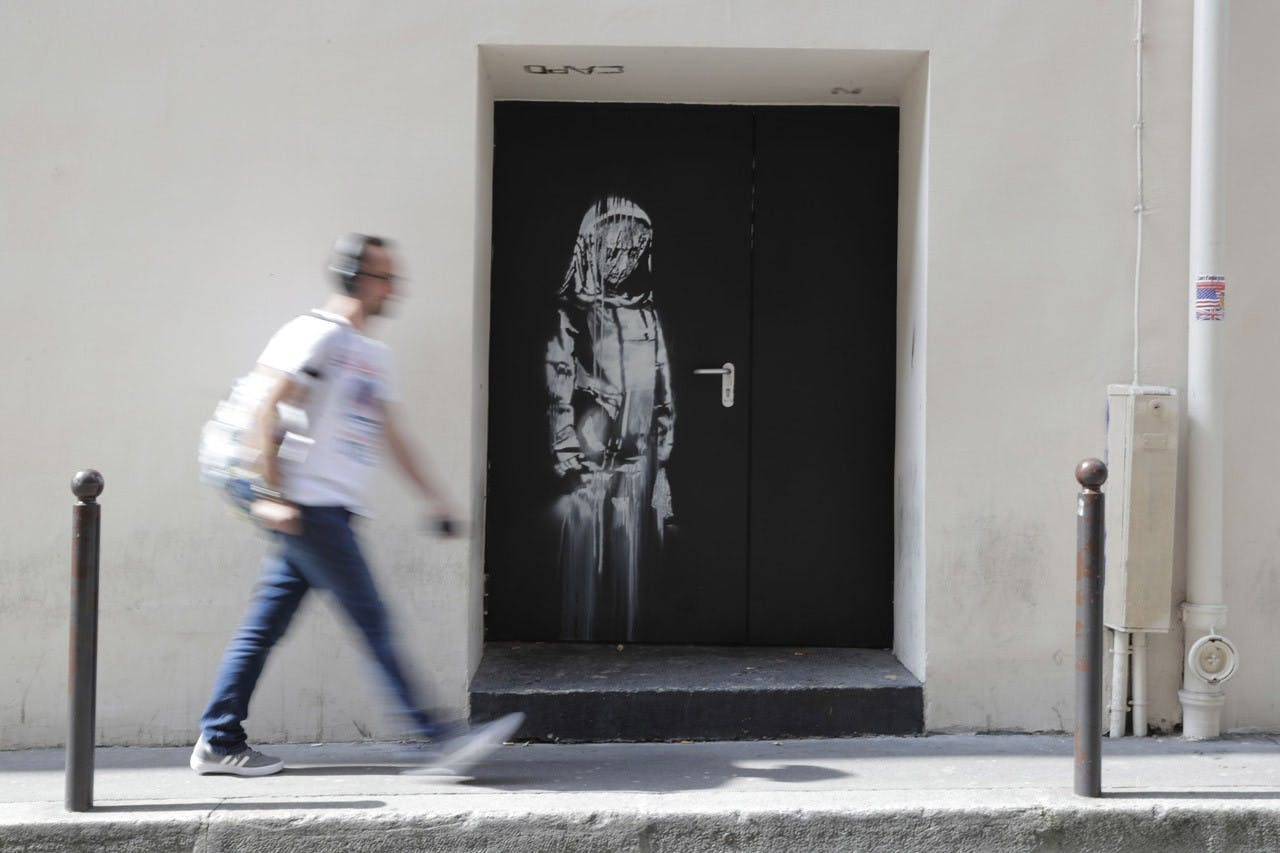 Banksy's artwork on the door of Bataclan in Paris.
