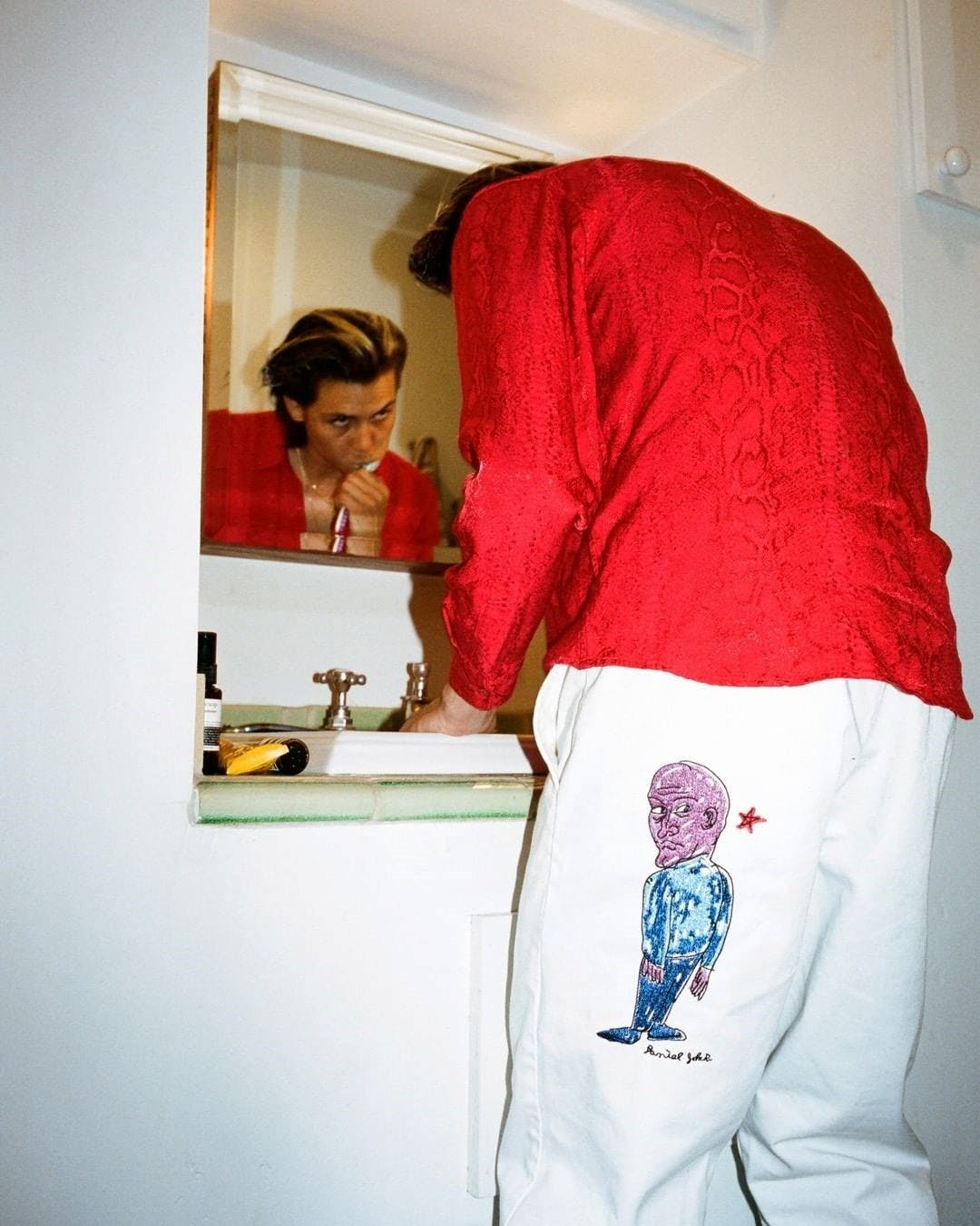 Supreme capsule collection featuring artwork by legendary musician Daniel Johnston - White pants.