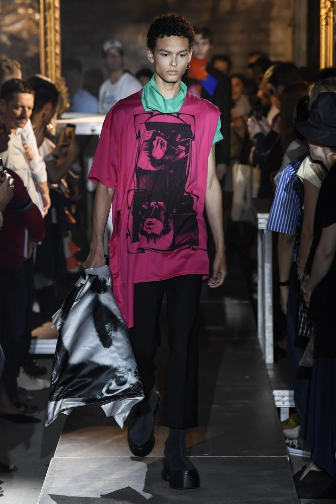 raf simons runway show ss19 pink one sleeve pink print shirt black cropped trousers white eastpak collaboration large backpack