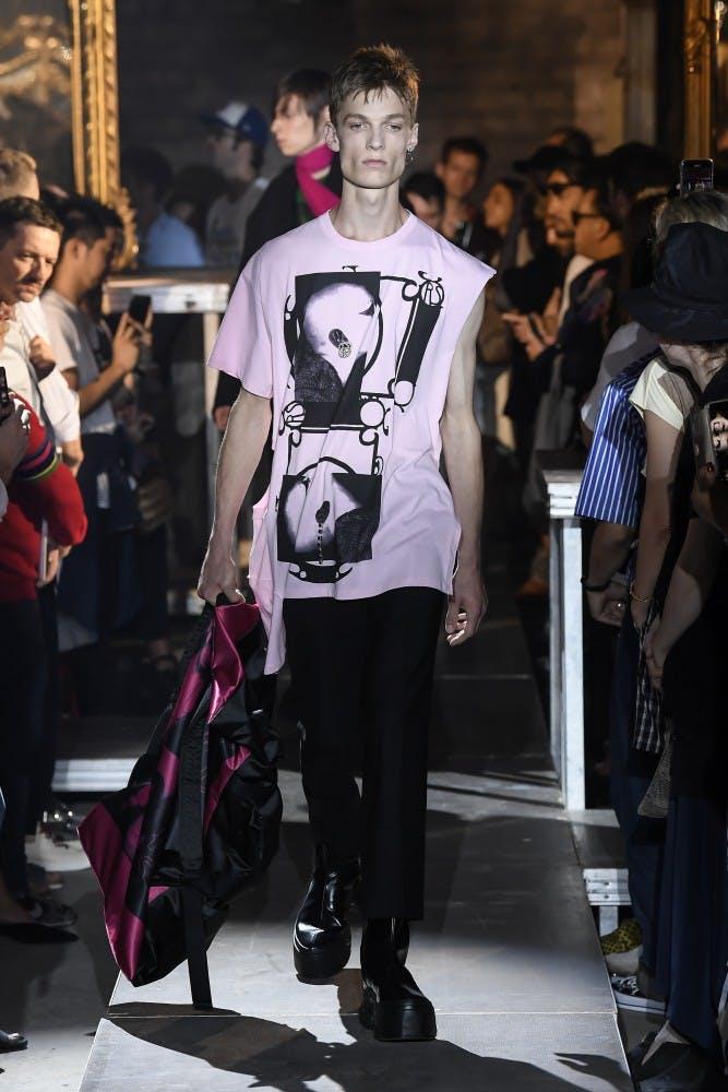 raf simons runway show ss19 pink sleeveless print shirt black trousers pink eastpak collaboration medium backpack
