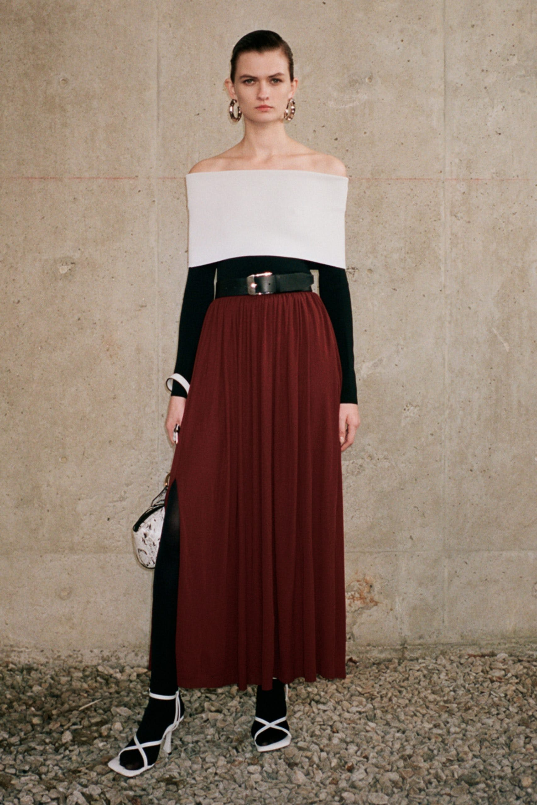 proenza schouler black folder white top black belt red high waisted pleated slit skirt