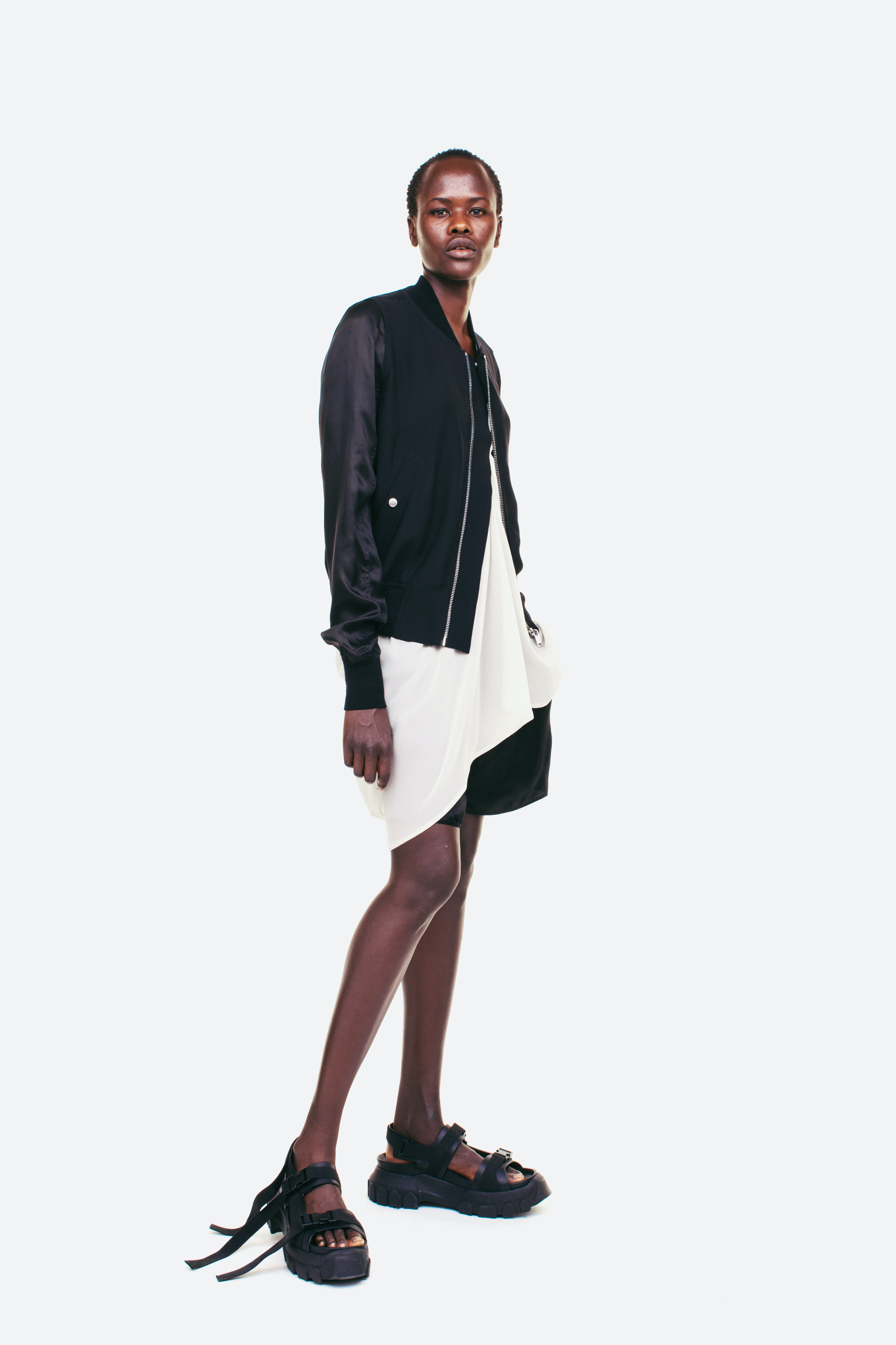 Rick Owens Campaign Bomber Silk Sleeve Jacket In Black Loose Fit Asymmetrical T Shirt in White Loose Fit Shorts in Black Long Strap Sandals in Black Womens SS19 Pre Collection