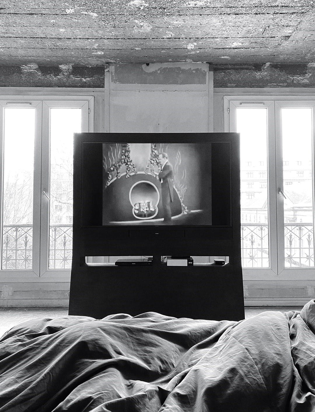 Rick Owens watching Nazimova's Camille in his Parisian apartment.