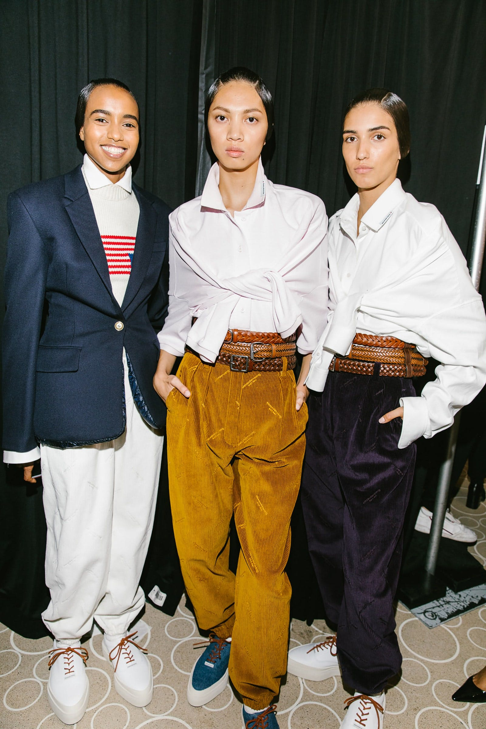 Alexander Wang Backstage Models Backstage in Relaxed Oversized Blazer in Navy and Tie Front Longsleeved Shirts with Corduroy Logo Pants Spring 20 RTW