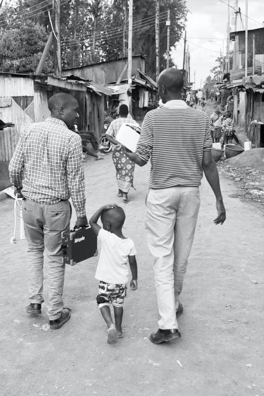 People carrying Jangala Big box in Kibagare