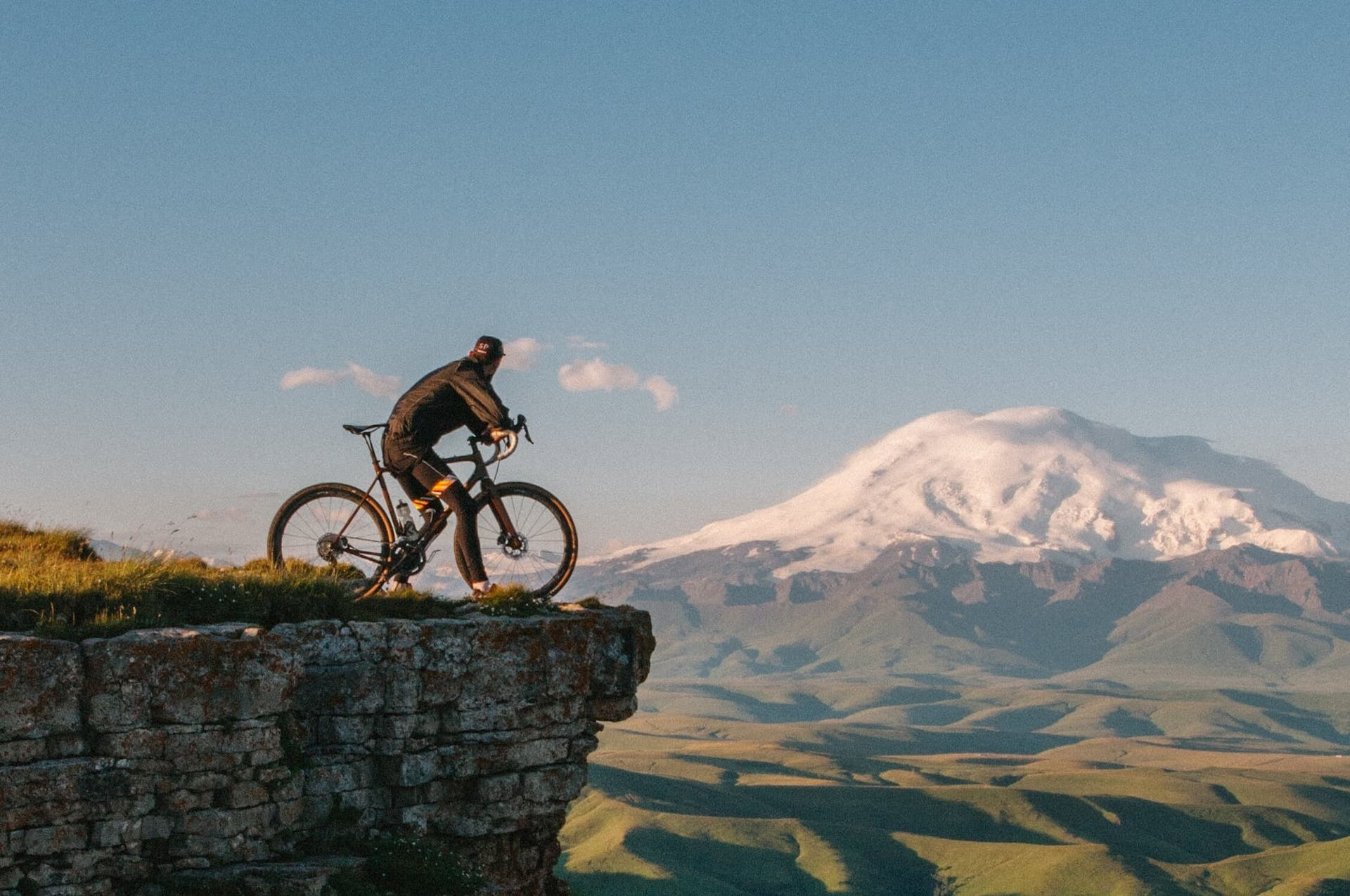 cyclist looking at mountains