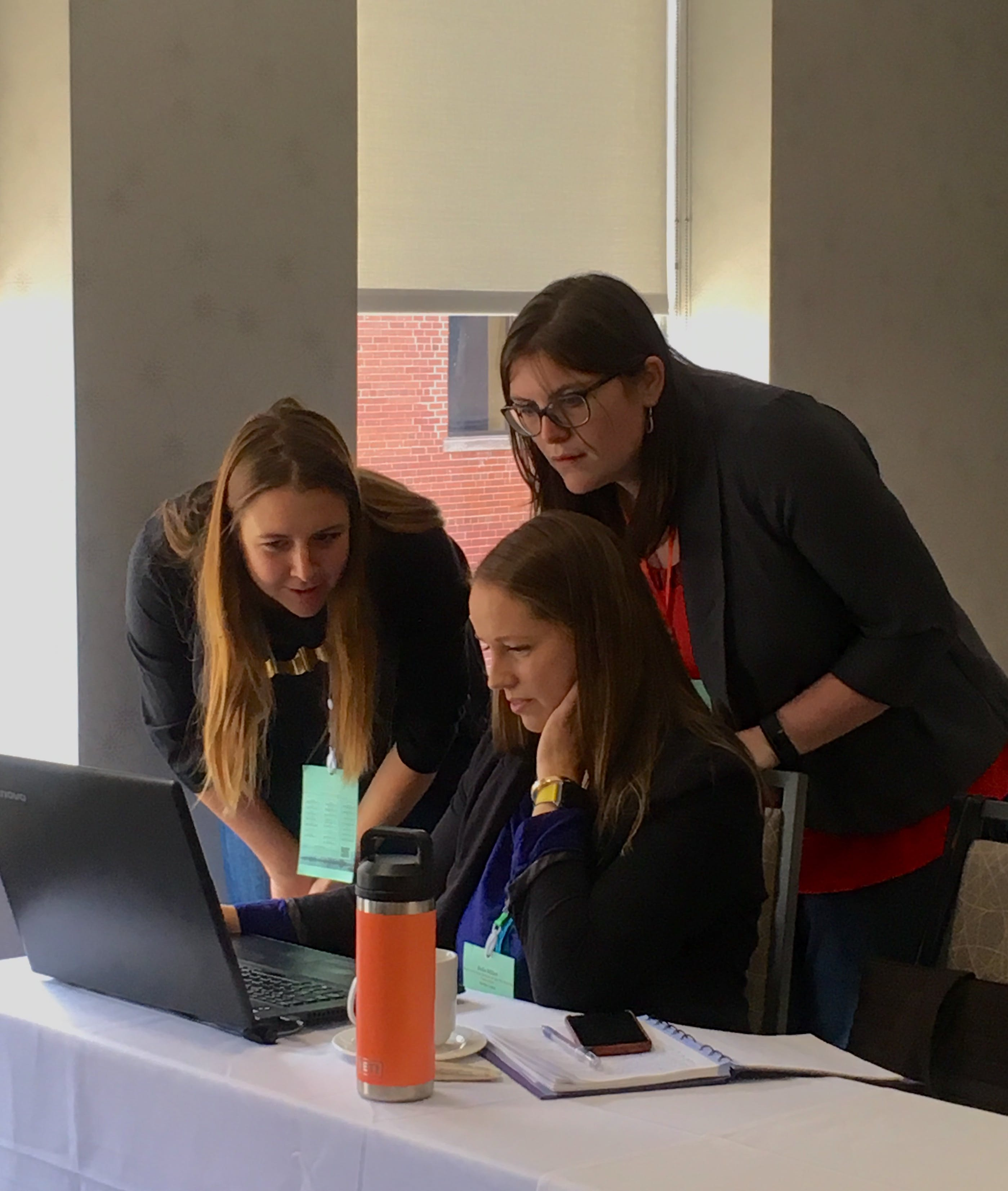 Chelsea and Emma assist a datathon participant