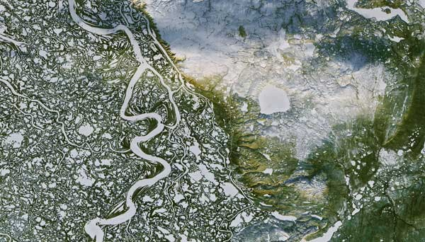 Watersheds are highly interconnected, often spanning geographical and political boundaries. Mackenzie River Delta, Northwest Territories (Image: NASA Earth Observatory).