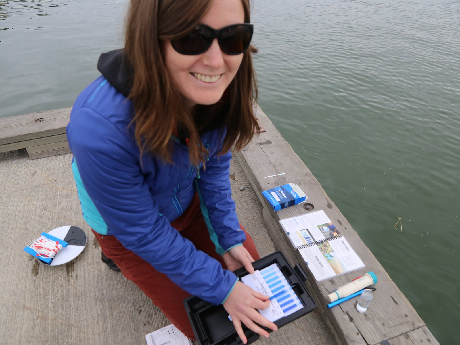 Nicole Goodman monitoring water with test strips.