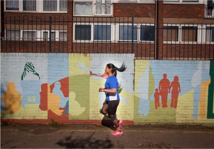 Woman running along the street