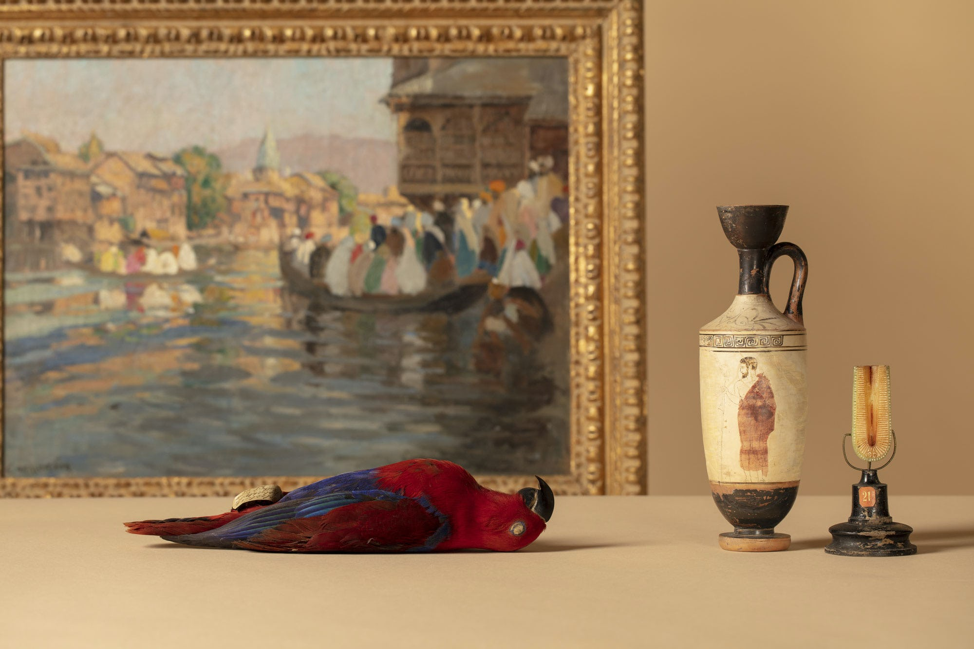 Still life of Museum artifacts, a dead parrot, painting and vase