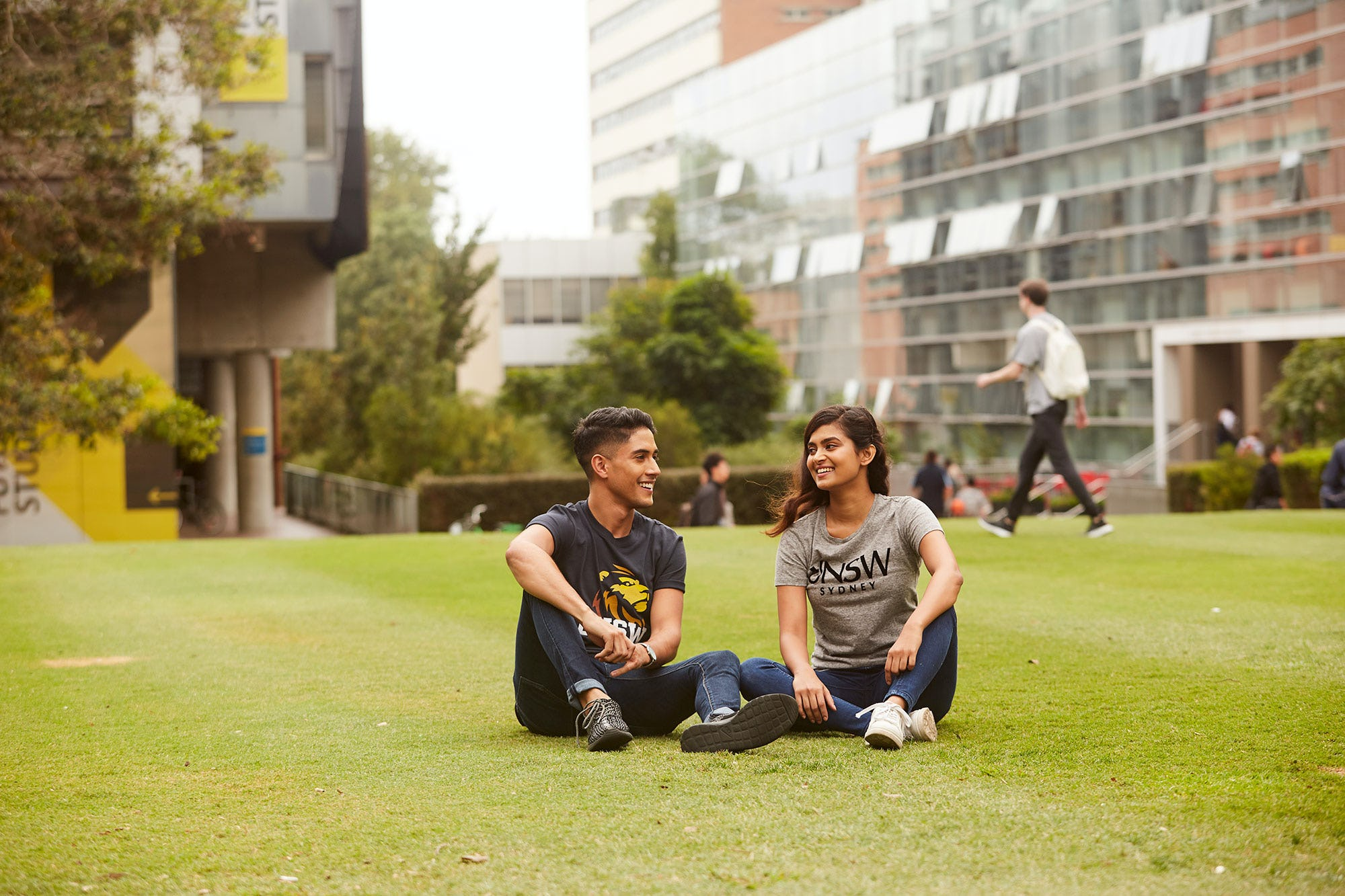 2 people on UNSW campus wearing UNSW clothing