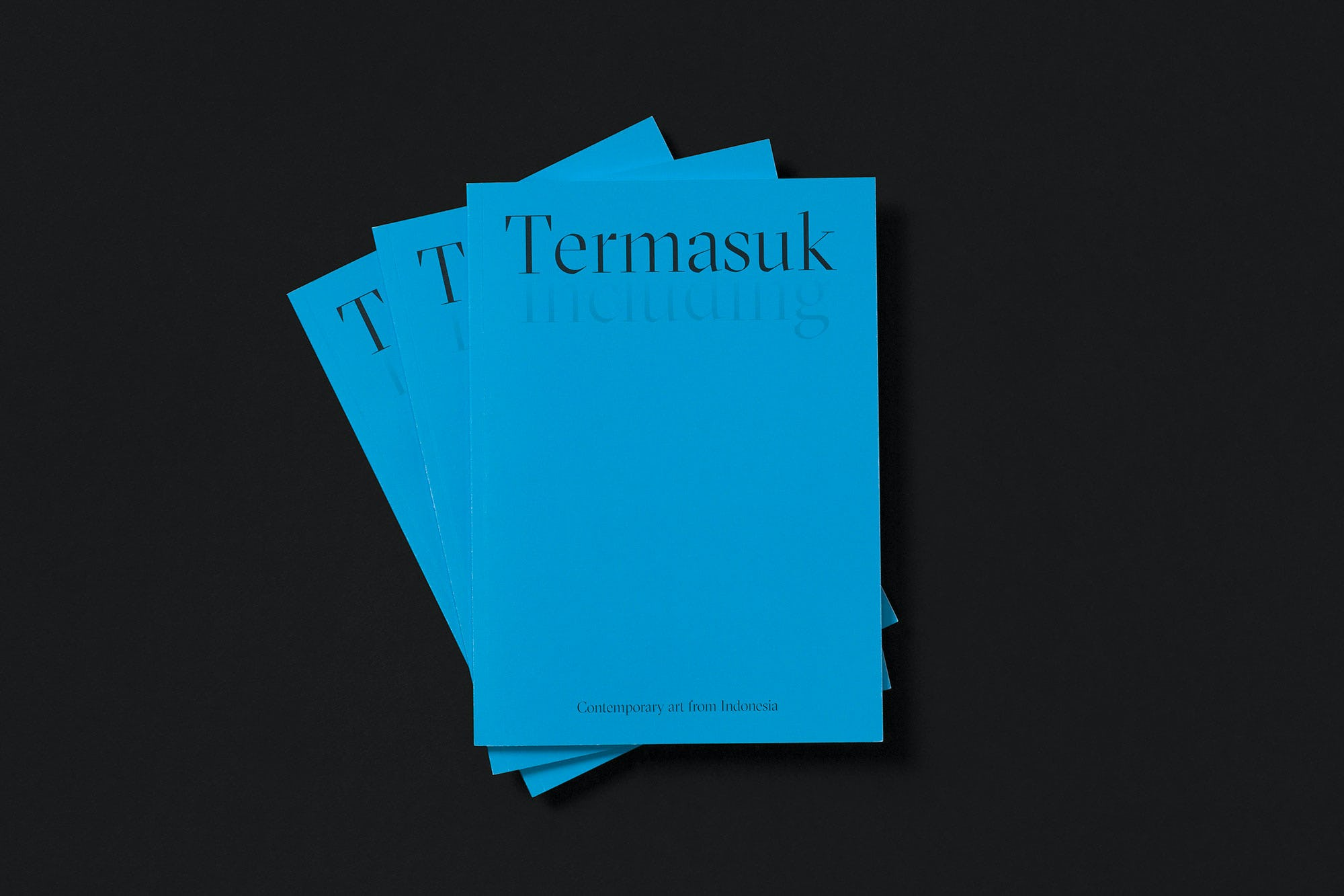 Three copies of the Termasuk catalogue