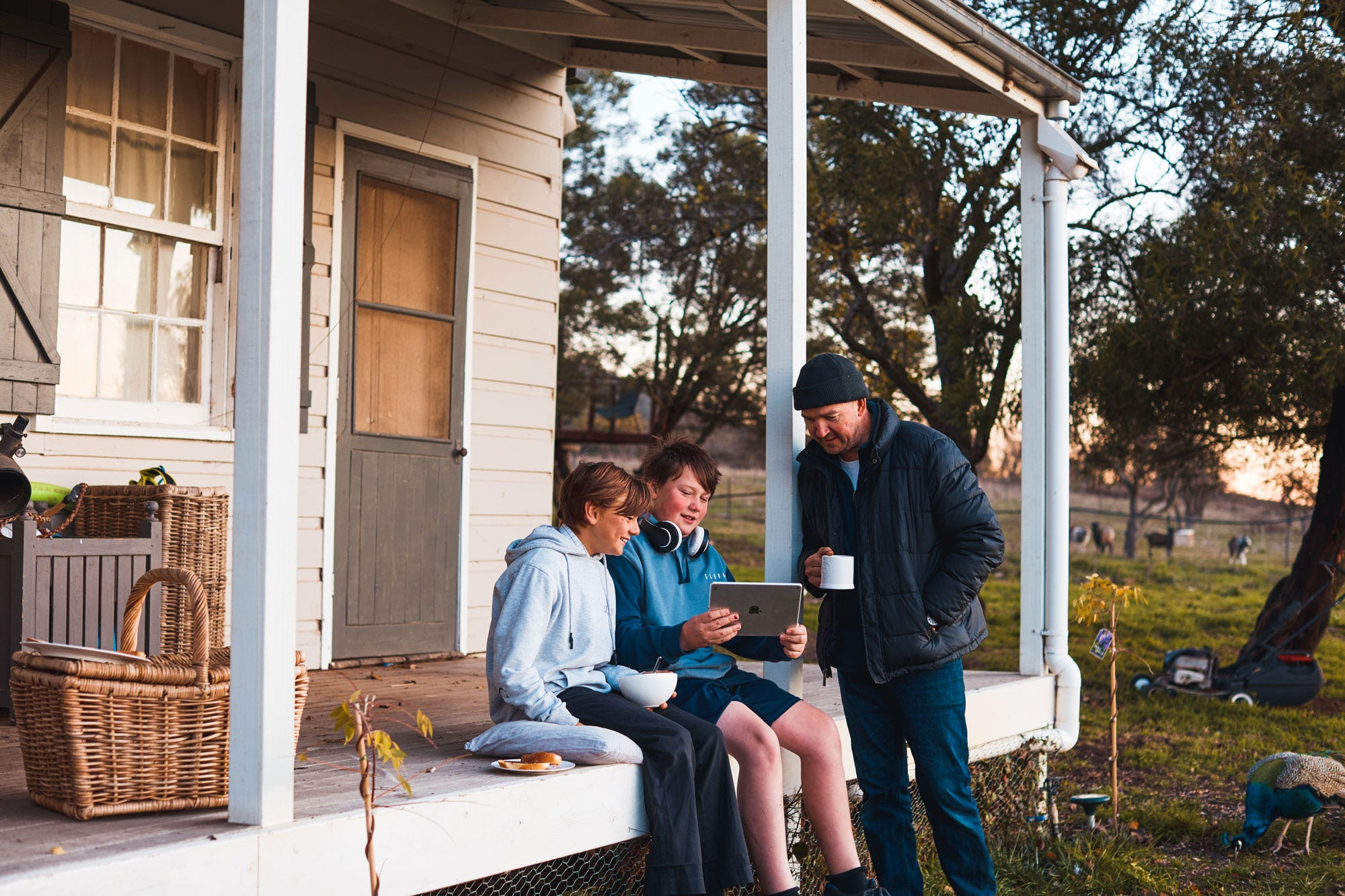 Two boys sitting on a porch in rural Australia