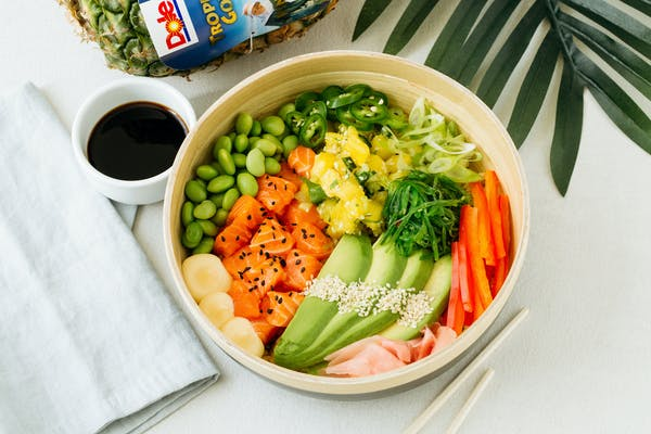 poke bowl with salmon avocado soy sauce and pineapple