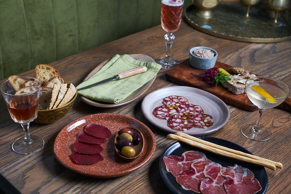 cazador spread of meats, breads, and olives